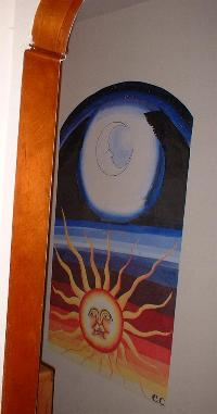 Eva painted a mural of the sun and the moon in a narrow hallway in her parents' house in Bowie, MD.